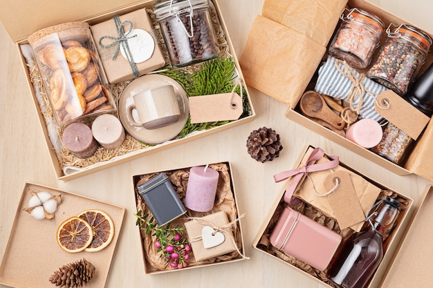 Preparing care package, seasonal gift box with coffee, cookies, candles, spices and cups. personalized eco friendly basket for family and friends