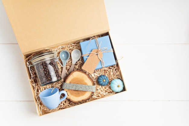 Preparing care package, seasonal gift box with plastic free, zero waste products for coffee lovers
