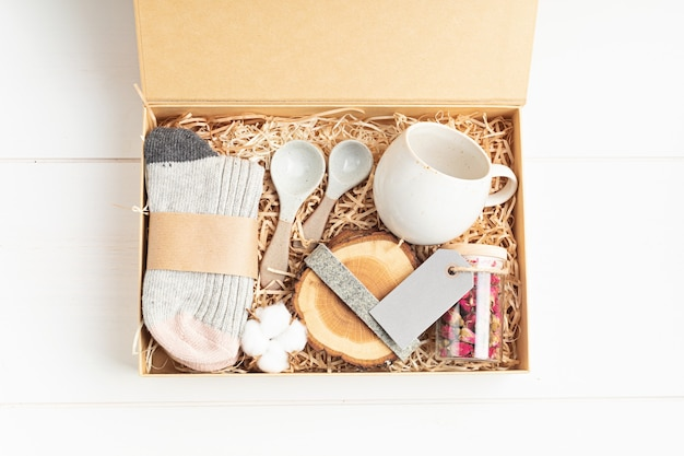 Preparing care package, seasonal gift box with plastic free, zero waste products.