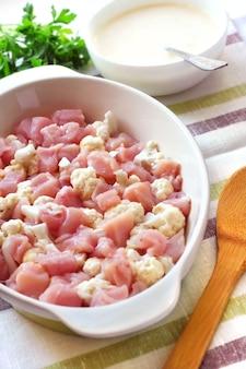 Preparing chicken breast and cauliflower casserole