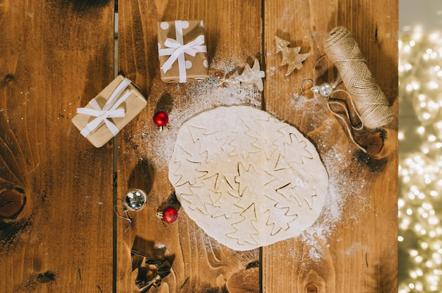 Preparing christmas cookies on a wooden surface