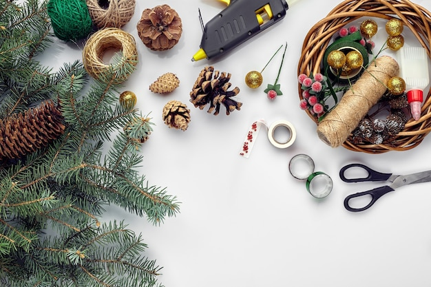 Preparing for christmas or new year holiday flatlay of fur tree branches wreaths rope scissors craft...