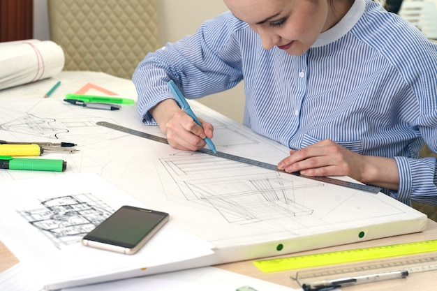 Preparing the design of the building, the architect draws a picture on white paper