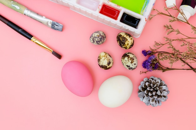 Preparing for easter on pink background in flat lay