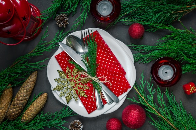 Preparing for the holiday, laying the stlola, crockery in festive decor various christmas