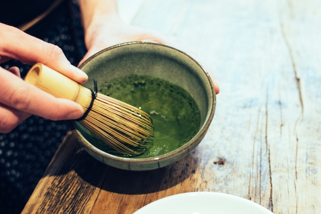 Preparing japanese matcha green tea