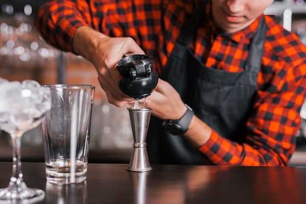 Preparing a refreshing cocktail in a bar