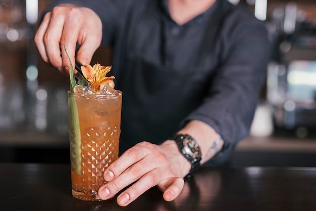 Preparing a refreshing cocktail in a bar