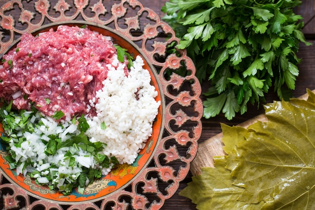 Preparing stuffed vine leaves with rice and meat, or traditional dolma.top view
