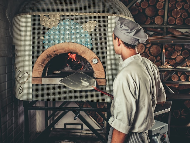 Preparing traditional italian pizza