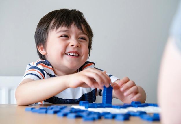 Preschool boy playing english upwords game
