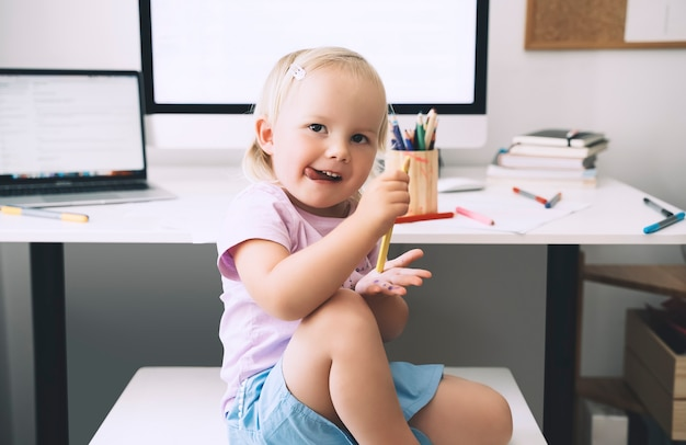 Preschool child using computer in early development or entertainment at home