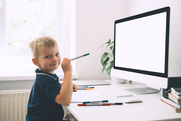 Preschool child using computer technology in early development or entertainment at home