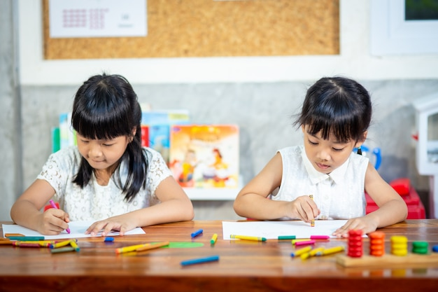 Preschooler child girl drawing and coloring