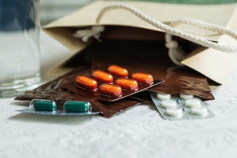 Prescription order from doctor with medicines, drug in plastic zip bags for patient