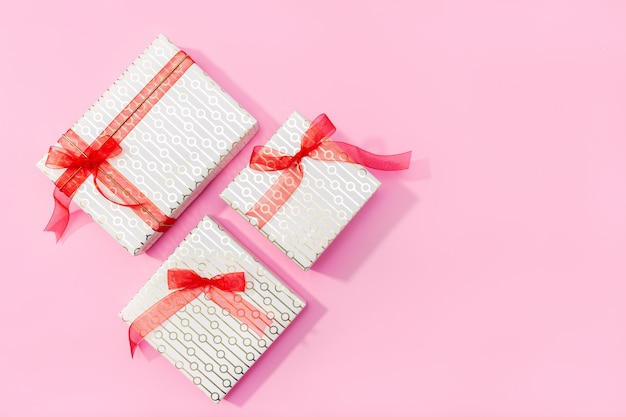 Present background. gifts on pink background. flat lay, top view, copy space