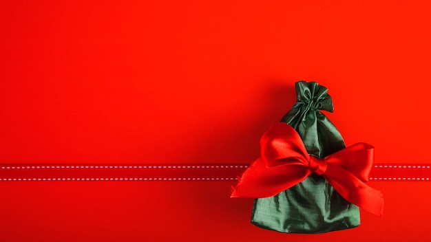 Present bag with red bow