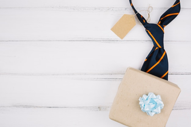 Present box near tie with tag