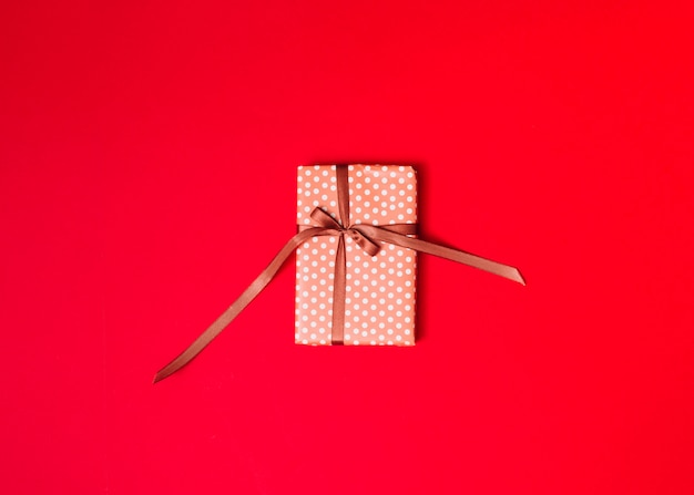 Present box in sweetie paper with ribbon