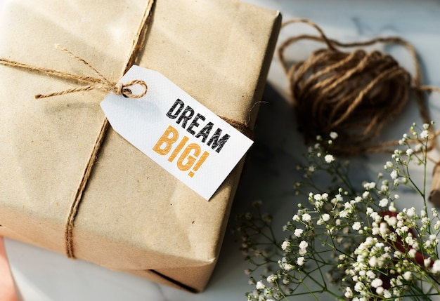 Present box with dream big tag