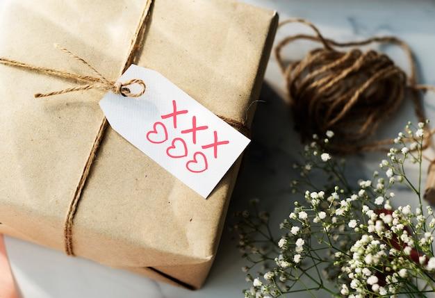 Present box with hearts and kisses symbols tag