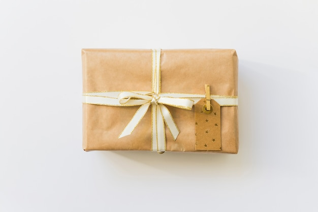 Present box in wrap with label