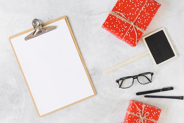 Present boxes, eyeglasses, clipboard and pens