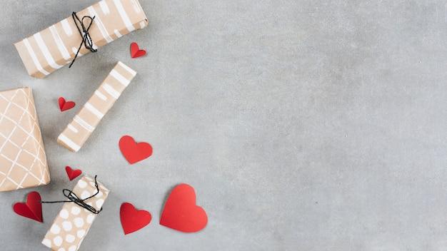 Present boxes near paper hearts