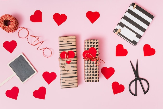 Present boxes, ornament hearts, notebook, scissors and tablet