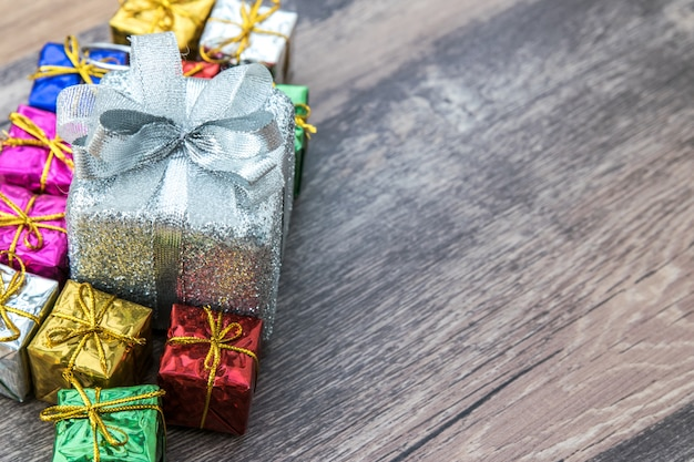 Present boxes on wooden background.