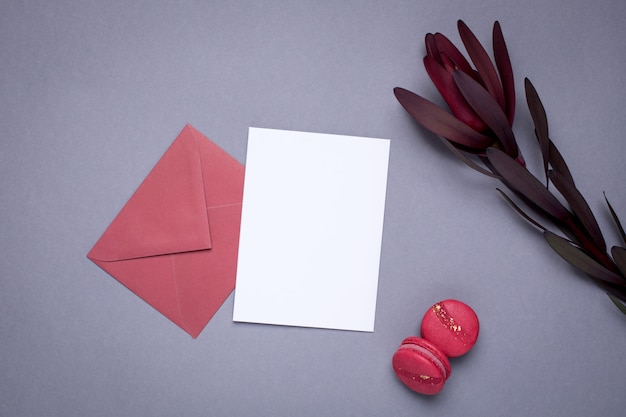 Present card , flower and macaroons on gray