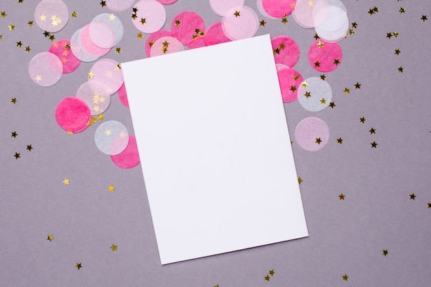 Present card and pink confetti with gold stars on gray