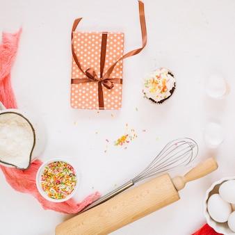 Present near ingredients and kitchenware