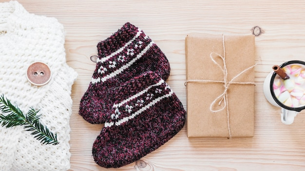 Present near warm clothes and hot chocolate