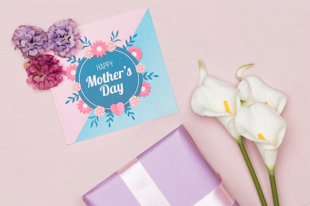 Present with flowers and card for mothers day