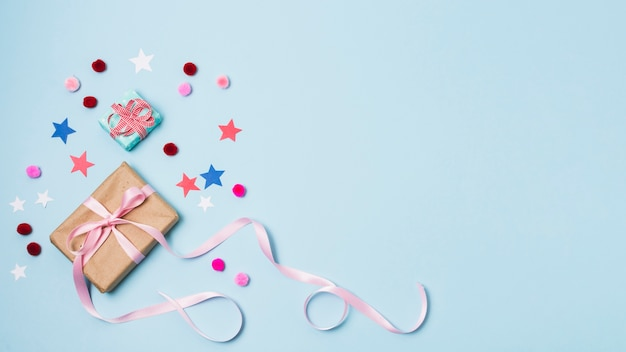 Present with stars and pom-poms