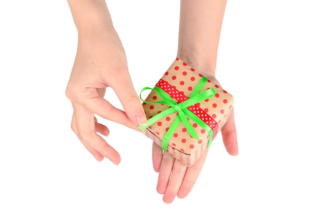 Present in woman hand on white background.