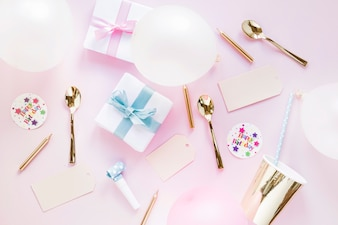Presents and party stuff on pink background