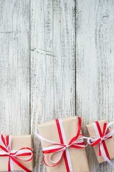 Presents for any holiday concept. gift boxes frame, top view with copy space on wood table background