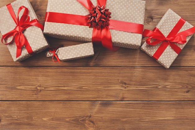 Presents for any holiday concept, gift boxes frame on wood