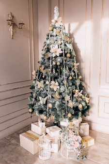 Presents and gifts under christmas tree, winter holiday concept