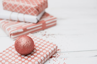 Presents in wraps near Christmas balls