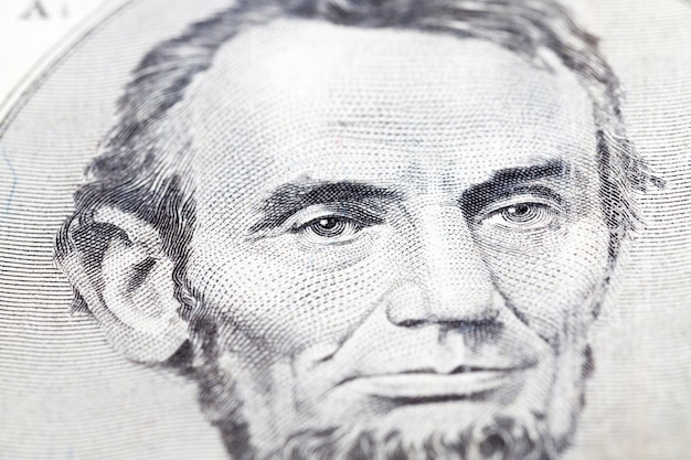 Of president lincoln an old bill five dollars the 1993 sample. close-up, in the focus of the president eyes