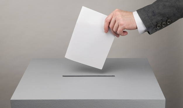 Presidential and parliamentary elections the voter throws the ballot into the ballot box