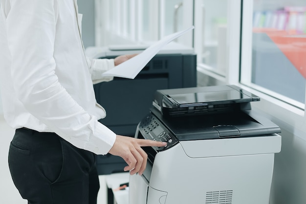 Press button on panel of printer scanner or laser copy machine in office