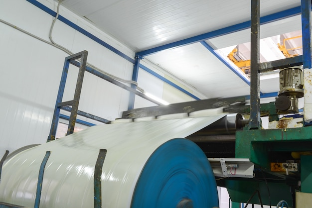 Press machine glues panel. plant for the production of sandwich panels from styrofoam