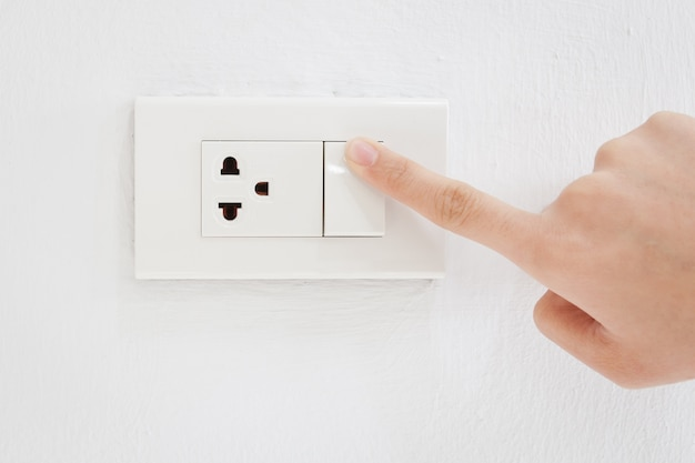 Press turn on electrical switch