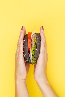 Pressed burger on yellow background