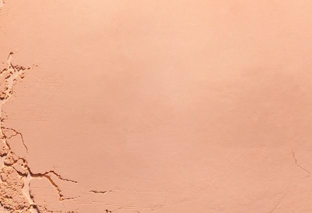 Прессованная пудра или румяна бежевый коричневый нежный текстурированный фон
