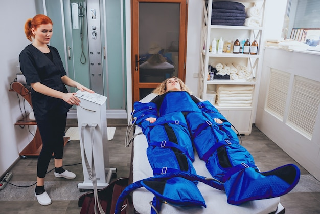 Pressotherapy machine on woman in beauty center